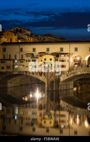 View of Gold (Ponte Vecchio) Bridge at night in Florence, Tuscany, Italy - Stock Photo