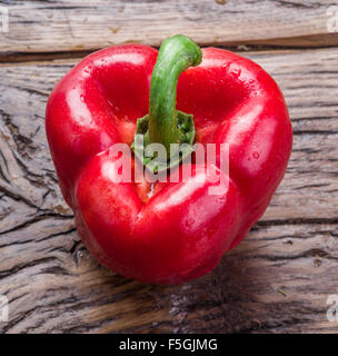 Fresh washed red paprika on the wooden table. - Stockfoto