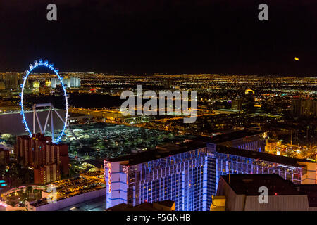 Las Vegas, Nevada at Night, The High Roller from the Eiffel Tower.  Rising Moon on far right. - Stock Photo
