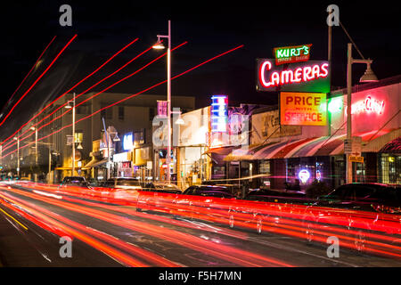 Kurt's Camera Corral neon sign and light streaks on Central Avenue (formerly Route 66), Nob Hill, Albuquerque, New - Stock Photo