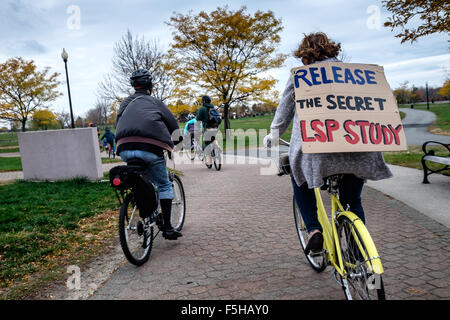 Jersey City, NJ, USA.  November 1, 2015:  A woman wears a sign asking for the 'release of the secret LSP Study' - Stock Photo