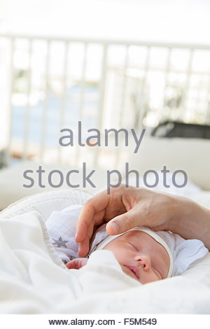 Sweden, Close-up of father stroking baby boy - Stock Photo