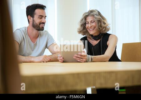 Businesswoman and male designer meeting in office - Stock Photo