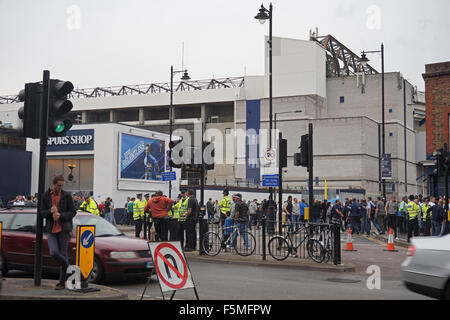 Football fans arriving at White Hart Lane, London, to watch Tottenham Hotspur play with a police presence to prevent - Stockfoto