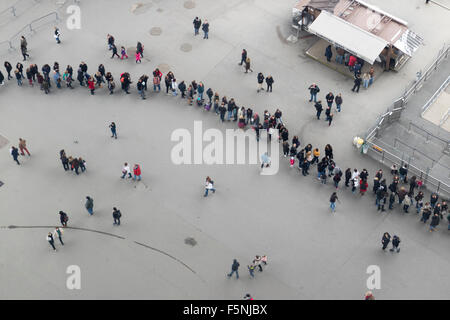 Rows of visitors seen from the Eiffel tower from the glass floor on the first floor - Stock Photo