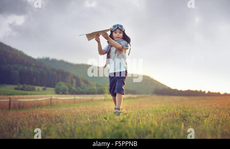 Cute little boy playing paper plane - Stock Photo