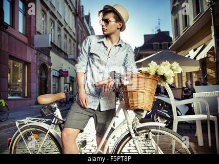 Elegant man on the retro bike - Stock Photo
