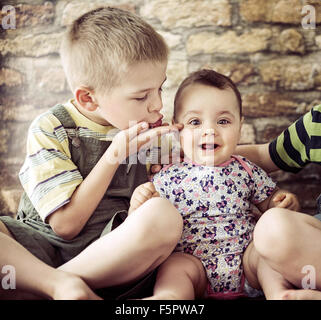 Portrait of the two cute children - Stock Photo