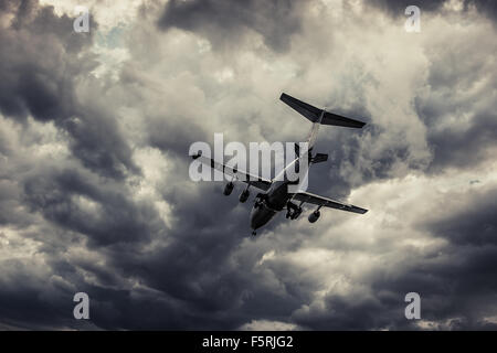 A passenger plane takes off from London City Airport - Stock Photo