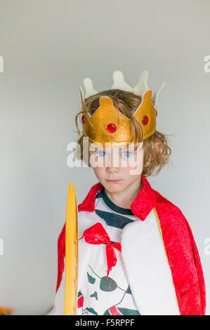 Sweden, Portrait of boy (6-7) in king's costume - Stock Photo