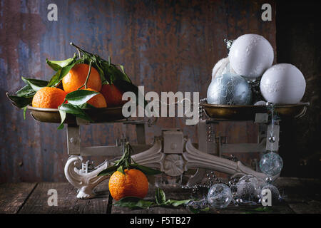 Tangerines and Christmas decorations - Stock Photo