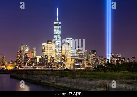Tribute in Light, two vertical columns of light rise above Lower Manhattan adjacent to the new World Trade Center, - Stock Photo