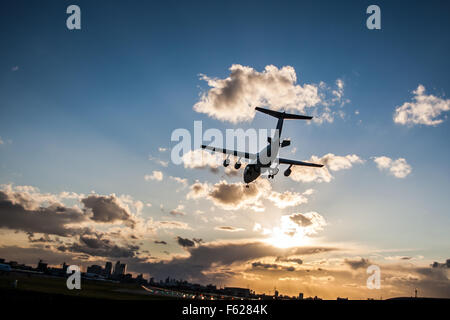 A plane landing at London City Airport - Stock Photo