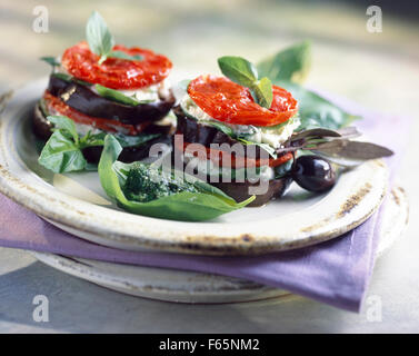 Eggplant,tomato and mozzarella Mille-feuille with pistou - Stock Photo