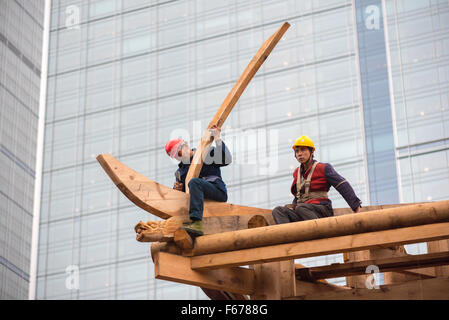 Chengdu, Sichuan Province, China - Nov 13, 2015: Chinese carpenters building a temple at the Daci monastery . - Stock Photo