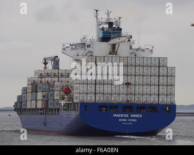 Maersk Nimes - IMO 9434931, leaving Port of Antwerp - Stock Photo