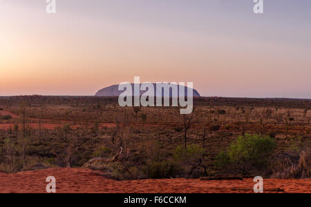 The Northern Territory Australia. Panoramic image of Ayers Rock at sunrise. - Stock Photo