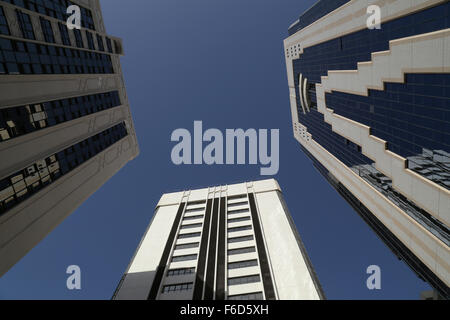 Skyscrapers - view from bottom, below blue sky - Stock Photo