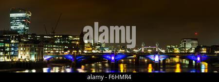 Panorama of Southwark bridge towards Tower bridge at night, London, England - Stock Photo