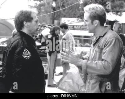 Jul 23, 2002; Hollywood, CA, USA; Producer JERRY BRUCKHEIMER listens to actor NICOLAS CAGES on the set of 'Gone - Stock Photo