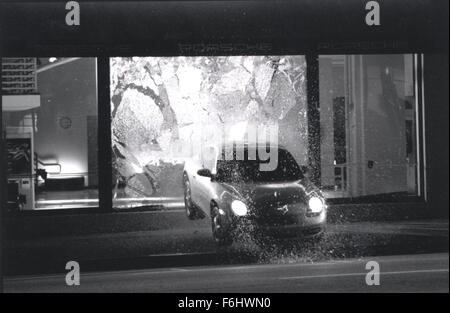 Jul 23, 2002; Hollywood, CA, USA; A car flies through a window as a stunt for the movie 'Gone in 60 Seconds.'.  - Stock Photo
