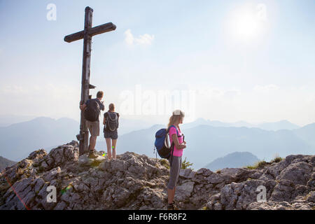 Group of friends on mountain peak - Stock Photo