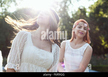 Young woman in hippie style fashion flicking her hair - Stock Photo