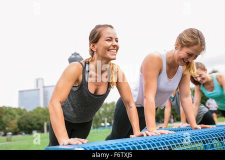 Four women having an outdoor workout - Stock Photo