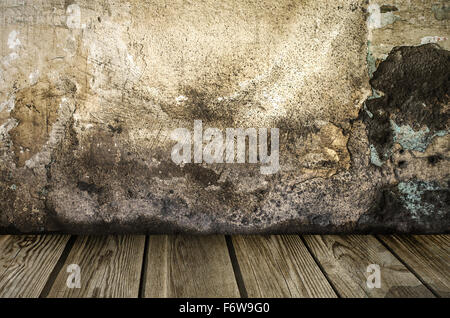 Grunge wall with wooden plank floor - Stock Photo