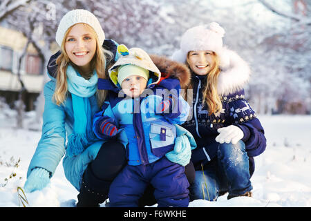 happy mother and children in winter park - Stock Photo