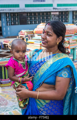 Indian lady in blue sari with daughter, Kapaleeswarar Temple, a Hindu temple of Shiva located in Mylapore, Chennai, - Stock Photo