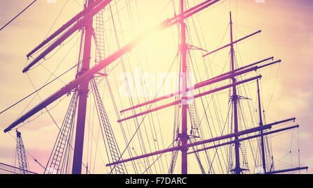 Retro vintage toned sailing masts at sunset, travel concept. - Stockfoto