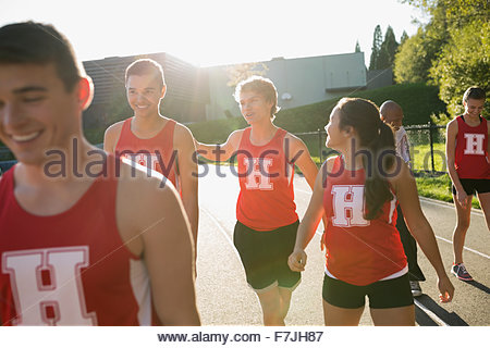 High school track and field team running track - Stock Photo