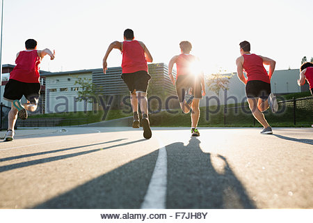 High school track and field athletes running track - Stock Photo