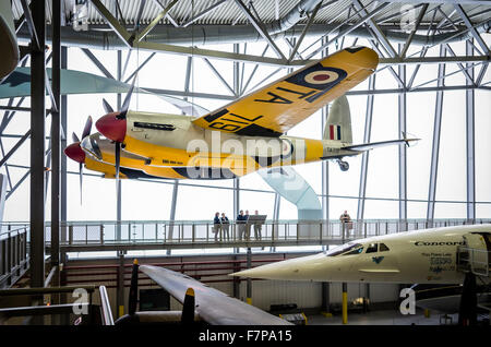 De Haviland Mosquito suspended from ceiling inside the Aerospace museum at Duxford Cambridgeshire UK - Stock Photo