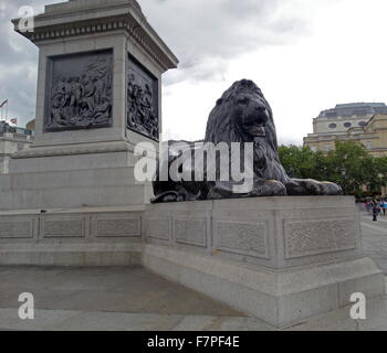 Lion statue at the base of Nelson's Column monument in Trafalgar Square in central London. 2015 Lion statue at the - Stock Photo