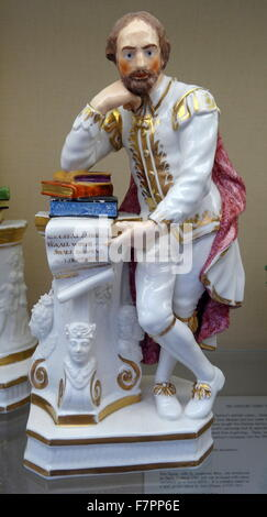 Porcelain, slip-cast painted in enamels and gilded, figure of William Shakespeare (1564-1616) English poet, playwright, - Stock Photo