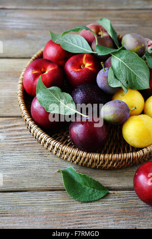 fresh and ripe plums on plate, fruits closeup - Stock Photo