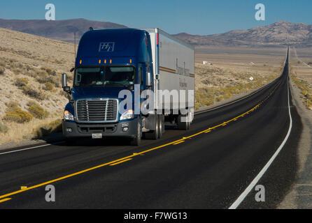 Truck on highway, Nevada - Stock Photo