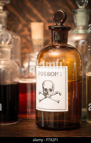 Bottles with poison label - Stock Photo
