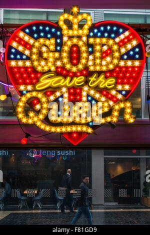 Illuminated art work 'God save the Queen' by Chris Bracey ('Neon Man') in Festival Hall at the Festival Of Love - Stock Photo