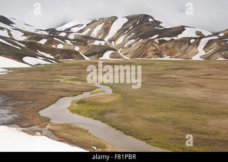 Snow covered mountains in the Icelandic Highlands at Landmannalaugar - Stock Photo