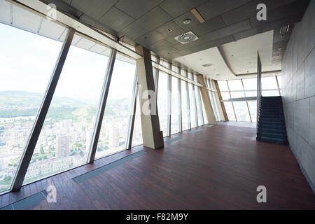 modern bright empty office or living room  interior with big windows and stairs - Stock Photo
