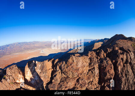 View from mountain peak over Death Valley panorama - Stock Photo