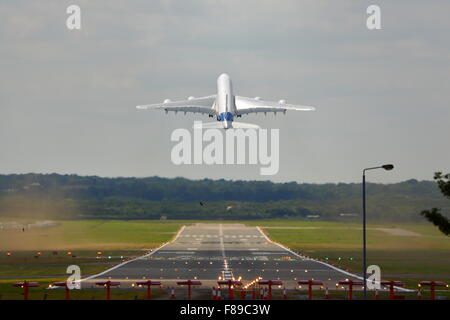 An Airbus A380 taking off at Farnborough Air Show 2014 - Stock Photo