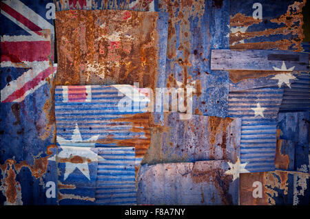 An abstract background image of the flag of Australia painted on to rusty corrugated iron sheets overlapping to - Stock Photo