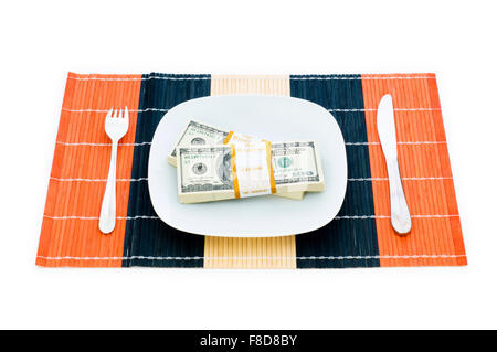 Financial concept - eating money isolated on white - Stock Photo