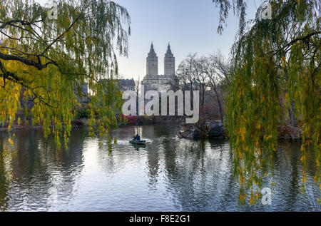 New York City - December 5, 2015: Central Park Lake at twilight. - Stock Photo