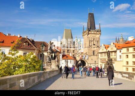 Tourists on Charles Bridge, view towards Mala Strana, Prague Old Town, Czech Republic, UNESCO - Stock Photo