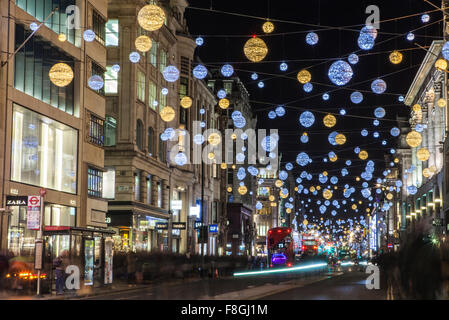 LONDON, UK - DECEMBER 9TH 2015: A view of a bustling Oxford Street during the lead up to Christmas in London, on - Stock Photo